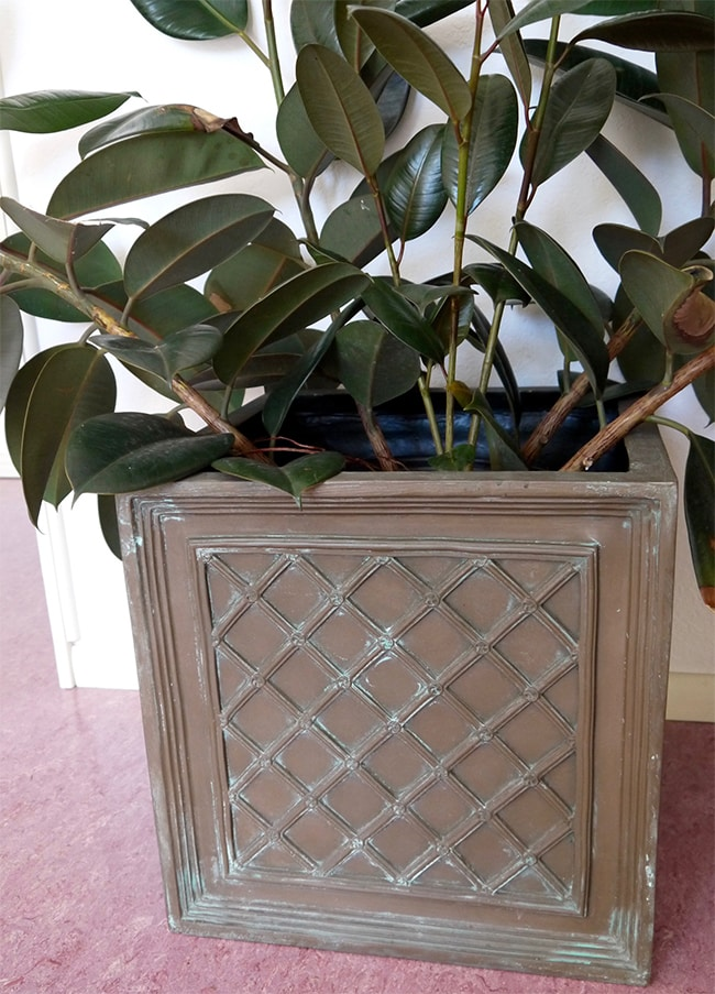 updating a decorative plant pot with painting