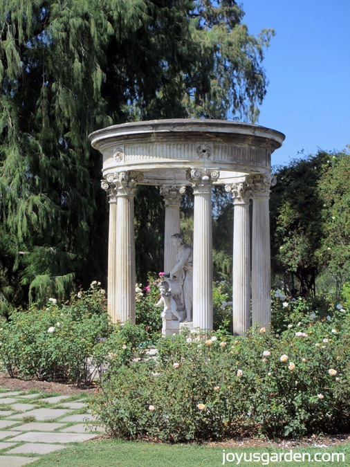 A seating area with columns in the Rose Garden
