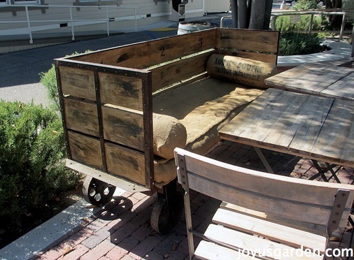 "at Sarloos & Sons - love this rustic wheeled ""loveseat"""