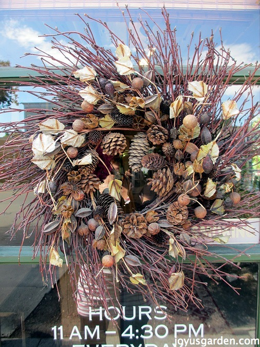 A natural wreath on the tasting room door