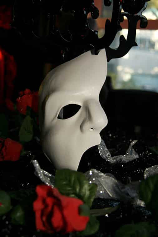 A Phantom of the Opera mask adds to the decor