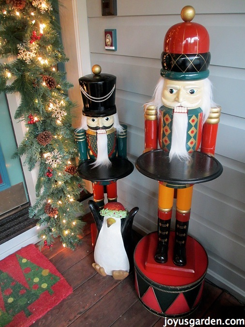 Nutcrackers on the porch by day