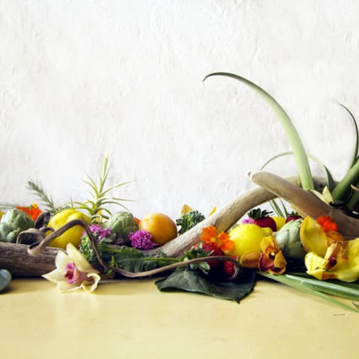 An Edible Centerpiece Accented With Driftwood, Flowers, Succulents & Air Plants
