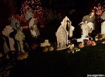 a spooky halloween graveyard scene at night