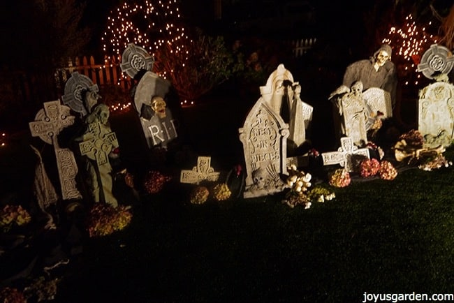 a spooky halloween graveyard scene at night
