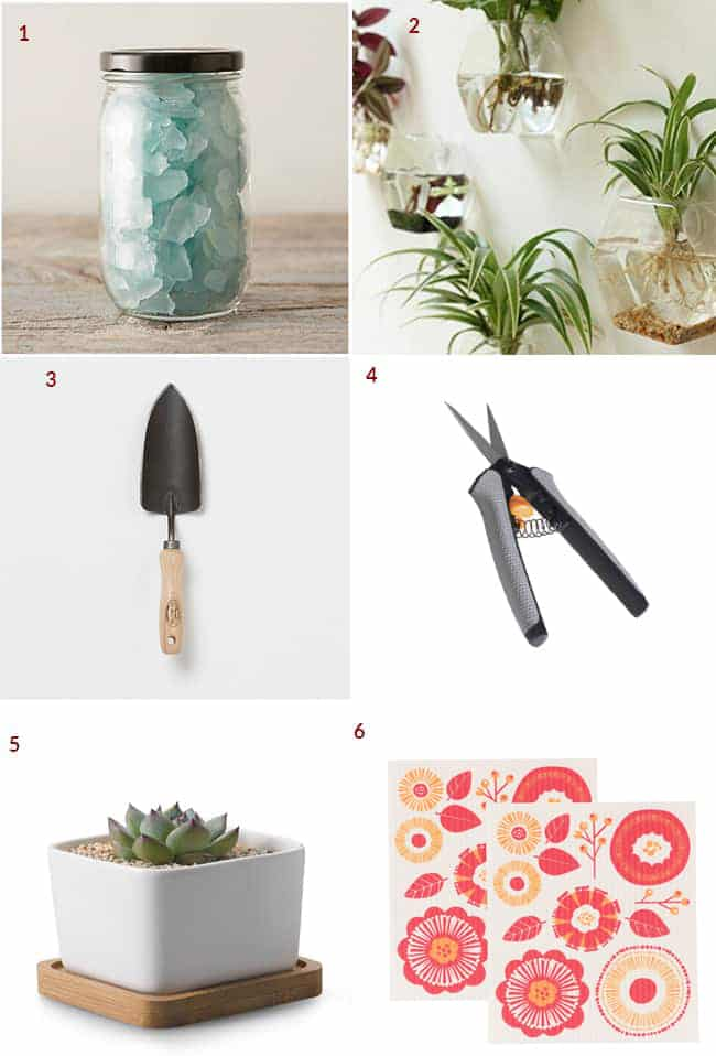a collage with gifts for houseplants lovers which includes decorative glass chips, glass globes to hang on the wall, a trowel, floral nippers, a square white pot & small towels with flowers