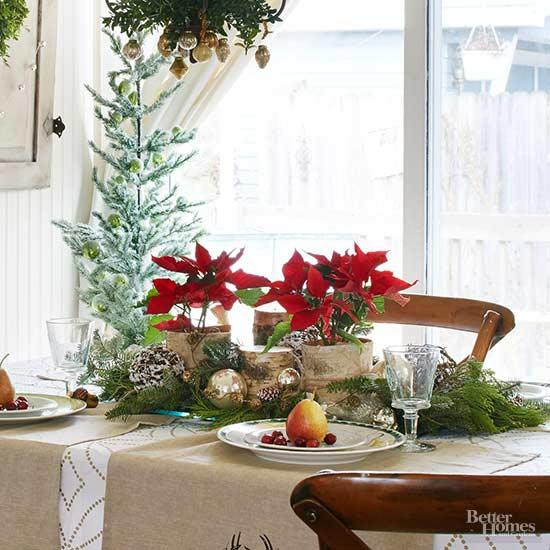 woodland inspired table centerpiece with red poinsettias