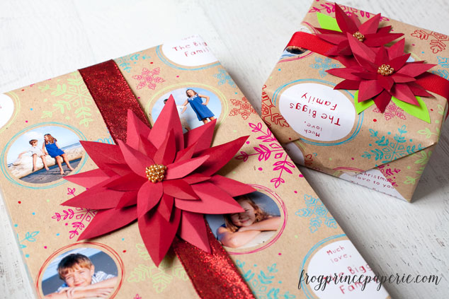 2 presents wrapped & adorned with paper red poinsettia bows