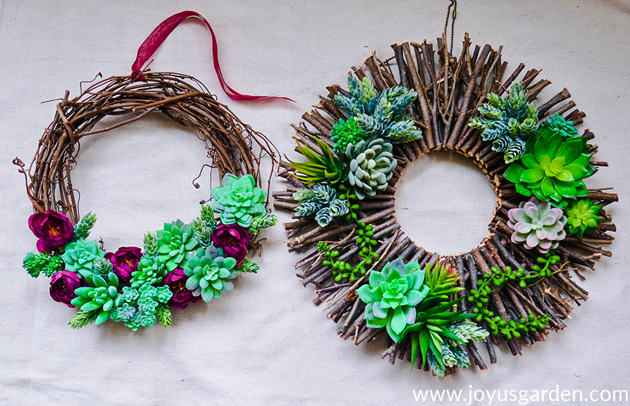 1 vine & 1 twig wreath decorated with faux succulents & faux flowers