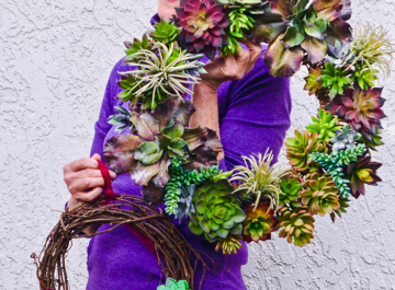 Nell Foster holding 2 DIY faux succulent wreaths she made