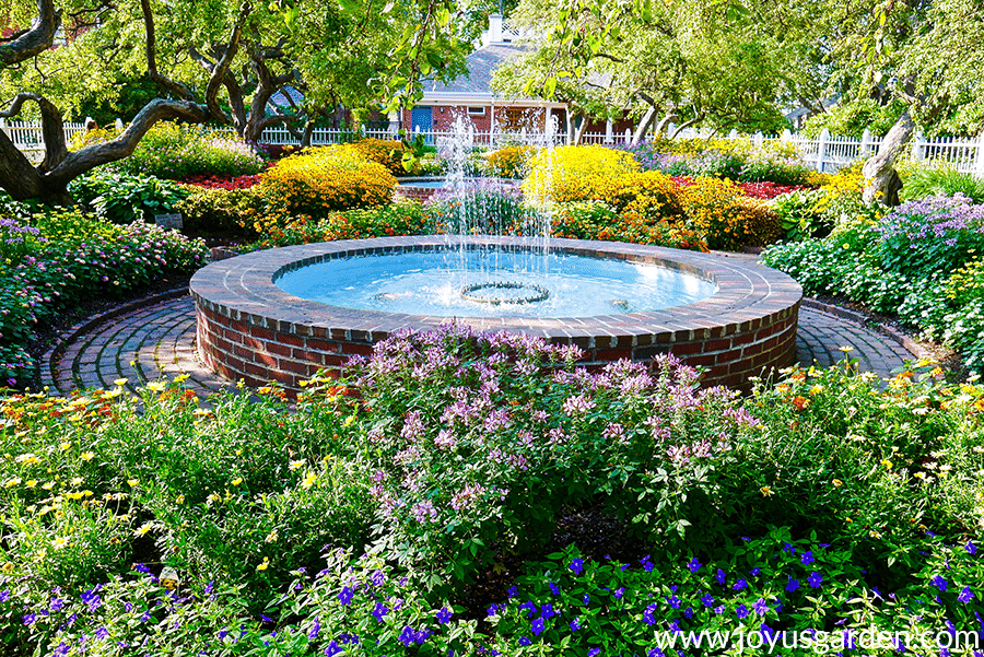 a beautiful flower garden with a water feature in portsmouth nh