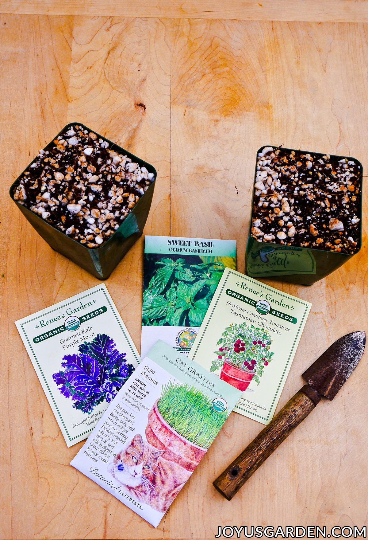"2 4"" grow pots filled with diy seed starting mix sit next to seed packets & a mini trowel"