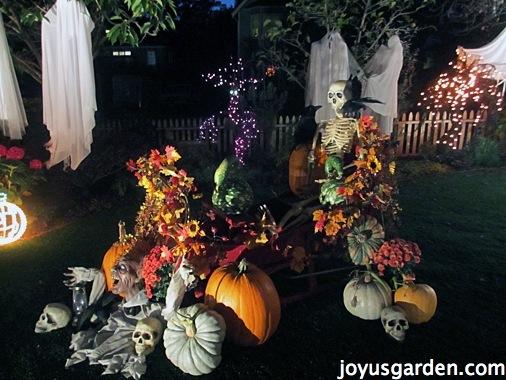 spooky halloween graveyard decor with tombstones and pumpkins