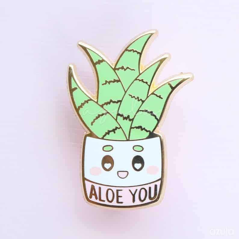 "a pin shaped like an Aloe Vera plant that says ""Aloe You"""