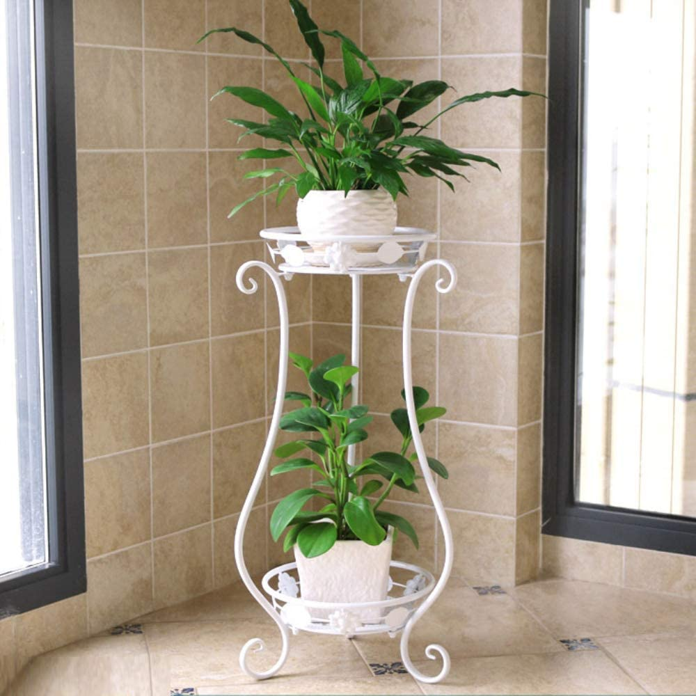 white wrought iron curvy plant stand with two tiers