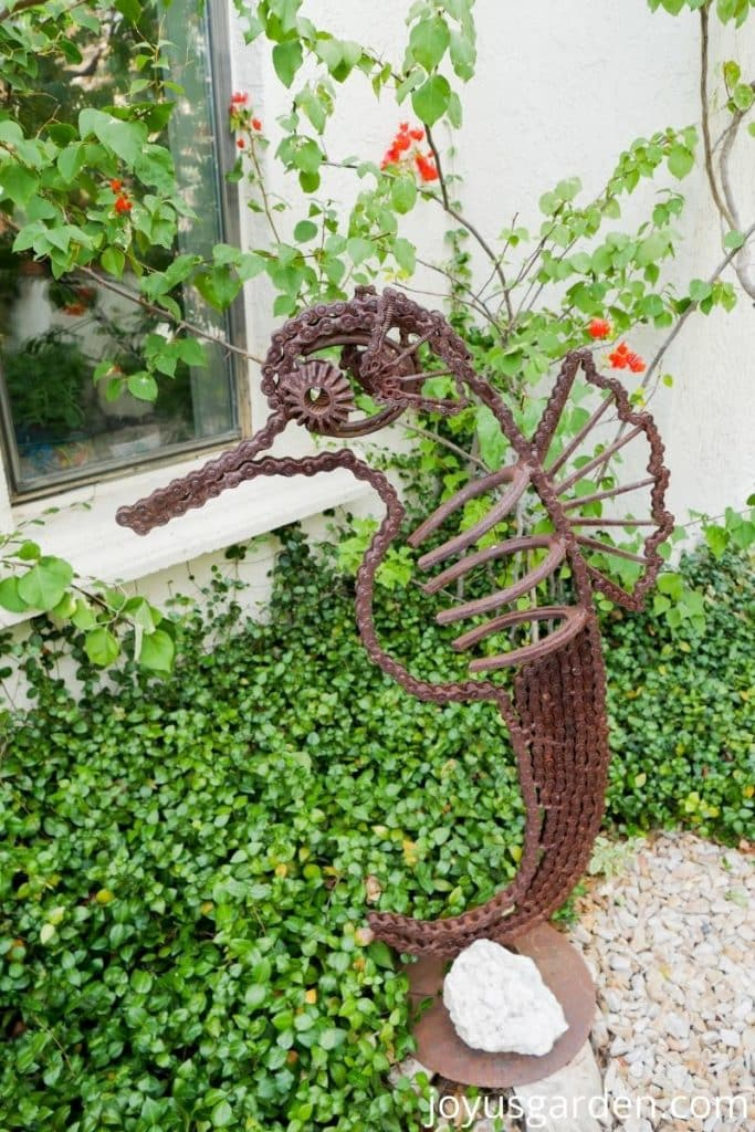 a seahorse made from recycled parts in a garden as art