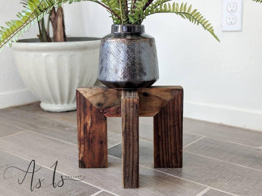 short dark wooden plant stand
