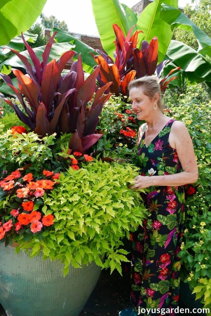 nell foster next to a large colorful container planting