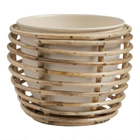 metal planter with rattan cane outside from world market