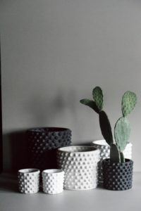 six ceramic pots in black and white from all modern