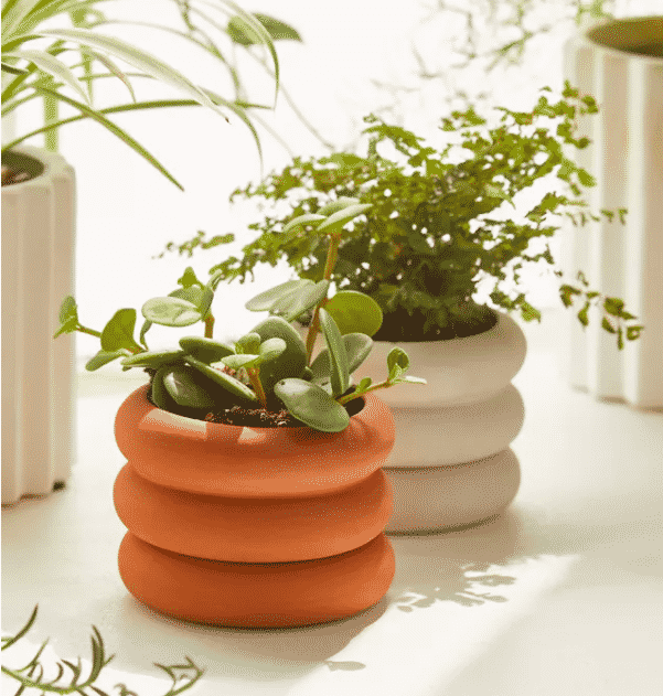 mini stacking pots with houseplants inside from urban outfitters
