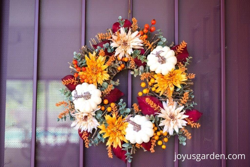 fall wreath hanging on front door
