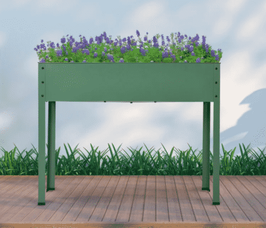 raised planter with purple plants potted inside